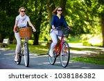 women biking in city | Shutterstock . vector #1038186382