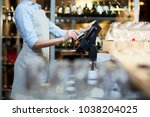 close up of waitress... | Shutterstock . vector #1038204025