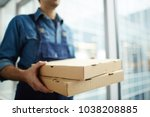 two boxes with fast food being... | Shutterstock . vector #1038208885