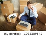 young businessman sitting on... | Shutterstock . vector #1038209542