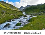 raging mountain river in green... | Shutterstock . vector #1038223126