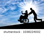 silhouette of a disabled man in ... | Shutterstock . vector #1038224032