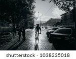 cyclist after rain   | Shutterstock . vector #1038235018