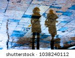reflection silhouette of two... | Shutterstock . vector #1038240112