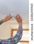 white male is installing smoke... | Shutterstock . vector #1038245965