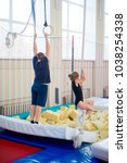 family in trampoline center | Shutterstock . vector #1038254338