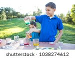 brothers coloring easter eggs | Shutterstock . vector #1038274612