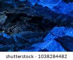 blue ice cave crystal frozen... | Shutterstock . vector #1038284482