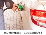 grey car at gas station being... | Shutterstock . vector #1038288055