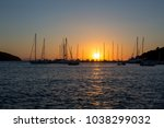 beautiful sunset in a harbour... | Shutterstock . vector #1038299032