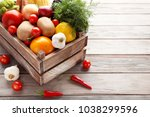 fresh vegetables in crate on... | Shutterstock . vector #1038299596