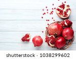 ripe and juicy pomegranate in... | Shutterstock . vector #1038299602