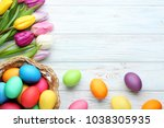 colorful easter eggs in basket... | Shutterstock . vector #1038305935