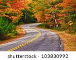 A Winding Road Curves Through...