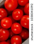 fresh red raw tomatoes in... | Shutterstock . vector #1038341092