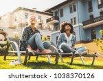 black and caucasian female... | Shutterstock . vector #1038370126