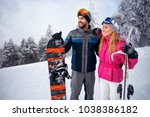young couple together skiing on ... | Shutterstock . vector #1038386182