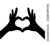 black girl hands making heart.... | Shutterstock .eps vector #1038389056