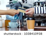 customer paying coffee by... | Shutterstock . vector #1038410938