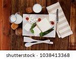 fresh white greek feta cheese... | Shutterstock . vector #1038413368