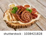 delicious grilled sausages with ... | Shutterstock . vector #1038421828