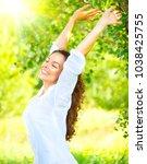 beautiful young woman enjoying... | Shutterstock . vector #1038425755