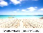wood deck  on blur blue sky and ...   Shutterstock . vector #1038440602
