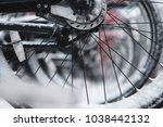 bikes in winter snow | Shutterstock . vector #1038442132