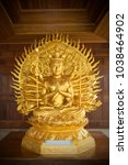 golden statue of guan yin with... | Shutterstock . vector #1038464902