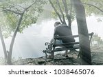 lonely man sitting on bench... | Shutterstock . vector #1038465076