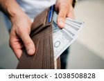 a doller bills in a wallet | Shutterstock . vector #1038508828