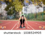 female sprinter getting ready... | Shutterstock . vector #1038524905
