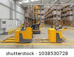 electric pallet trucks and... | Shutterstock . vector #1038530728