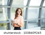 successful business woman with...   Shutterstock . vector #1038609265