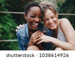 happy friends holding each other | Shutterstock . vector #1038614926