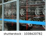 showcase with tires and alloy... | Shutterstock . vector #1038620782