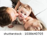 pretty yong family in bed.... | Shutterstock . vector #1038640705