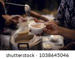 feeding the poor to hands of a... | Shutterstock . vector #1038645046