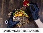 woman's hands in black rubber... | Shutterstock . vector #1038646882