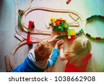 kids playing with toy railroad... | Shutterstock . vector #1038662908