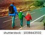 father with two kids walking on ... | Shutterstock . vector #1038663532