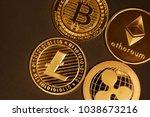 four gold coins ripple  bitcoin ... | Shutterstock . vector #1038673216