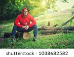 a slim athletic runner in a red ... | Shutterstock . vector #1038682582