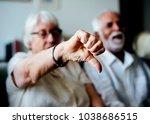 senior woman disagrees | Shutterstock . vector #1038686515