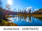 spring mountain river sunlight... | Shutterstock . vector #1038706552