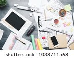top view of creative messy desk ... | Shutterstock . vector #1038711568