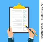 hand filling checklist on... | Shutterstock .eps vector #1038712972