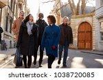 group of mature friends walking ... | Shutterstock . vector #1038720085