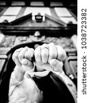Small photo of show off in front of the ornate two people of the wedding ring inblack and white, cool