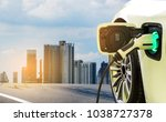 charging modern electric car on ... | Shutterstock . vector #1038727378